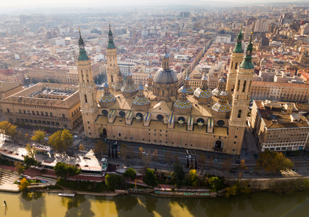 Picturesque view from drone of Basilica of Our Lady of Pillar on bank of Ebro river in Spanish city of Zaragoza