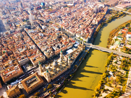 Aerial view of Zaragoza cityscape on bank of Ebro river in sunny autumn day, Spain