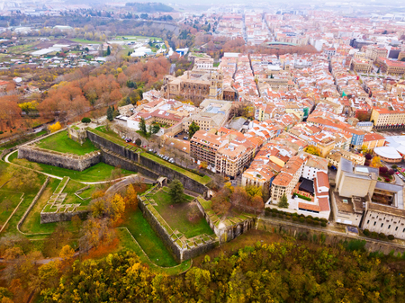 Aerial view of historic centre of Spanish city of Pamplona on bank of Arga river in autumn day