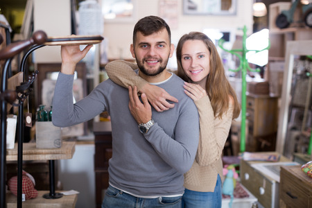 Portrait of wife and husband in antique furnishings store