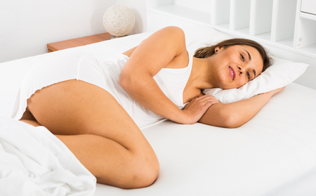 Smiling girl sleeping deeply in bed in morning Stock Photo - 115902070