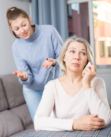Adult daughter blames her mom Stock Photo