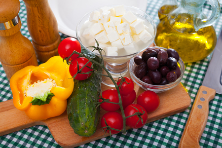 Traditional Greek fresh vegetable salad with feta cheese and herbs Stockfoto - 116124411