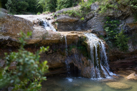El Torrent de la Cabana small mountain stream with crystal clear water