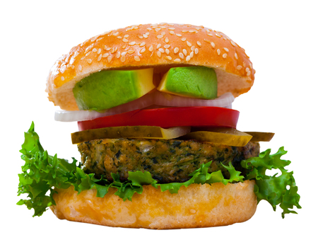 Juicy veggie burger with falafel, fresh tomatoes, onion, pickled cucumbers and ripe avocado. Isolated over white background