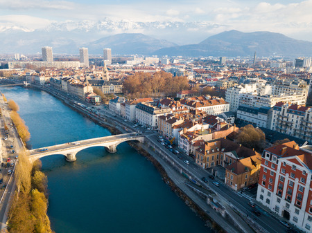 Aerial view Grenoble of city center with embankment of Isere river, France