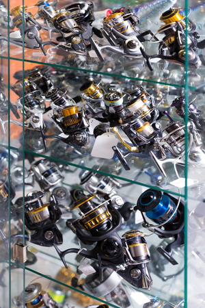 Image of stand with fine baitcasting reel for rod in the sports shop