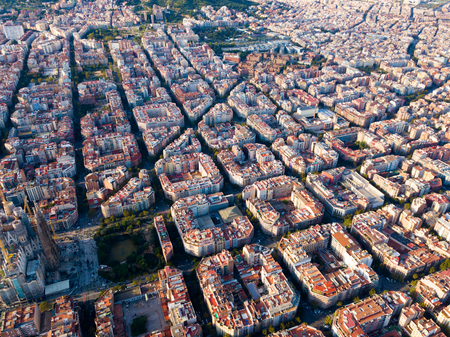 Panoramic view from drone of Eixample district with Sagrada Familia in Barcelona at sunny day, Spain 版權商用圖片