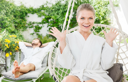 Happy attractive girl enjoying vacation with boyfriend in a luxury spa resort outdoors Фото со стока