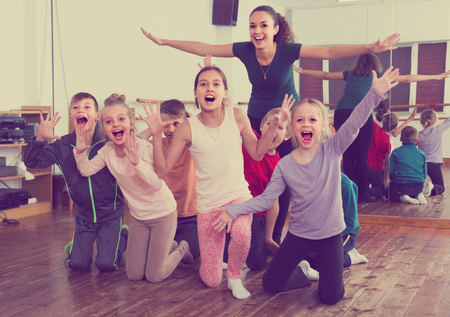 Active  emotional children  posing at dance  class  together