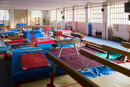 big acrobatic with gymnastic equipment –beams, bars and pommel horse Foto de archivo - 117109401