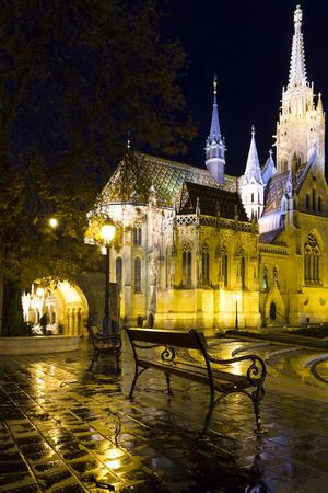 Lush Gothic architecture of Matthias Church on Buda hill in night lights, Hungary Stock Photo