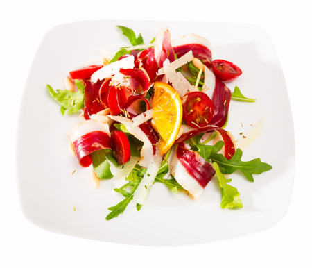 French salad Magret de canard seche closeup. Isolated over white background