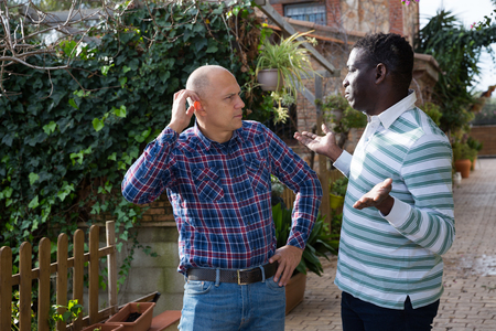 Quarrel of two neighbors in the country in the village Stock Photo - 117214744