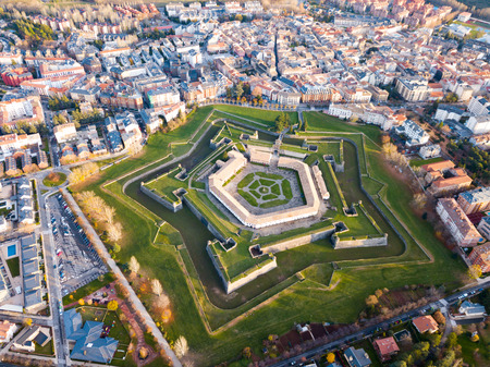 Scenic autumn view from drone of Spanish city of Jaca with pentagram-star shaped Citadel Stock Photo