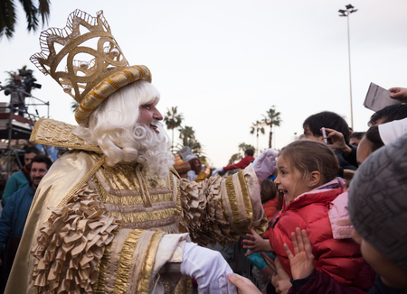 BARCELONA, SPAIN –  JANUARY 5, 2017: King-magician Melchor and his retinue take letters from children. Barcelona, Spain