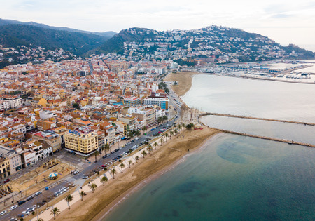 ROSES, SPAIN - FEBRUARY 02, 2019: Picturesque aerial view of Mediterranean coastal town and resort of Roses in Catalonia, Spain Archivio Fotografico - 124659177