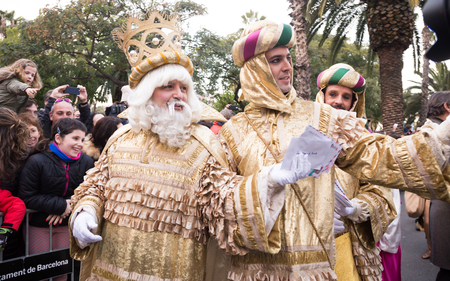 BARCELONA, SPAIN –  JANUARY 5, 2017: King Melchor with suite takes from children of letter. Barcelona, Catalonia