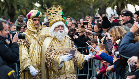 BARCELONA, SPAIN –  JANUARY 5, 2017: Three of Magi and his retinue take letters from children. Barcelona, Spain