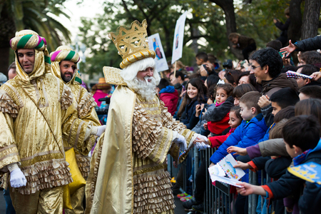 BARCELONA, SPAIN –  JANUARY 5, 2017: Three kings Melchor, Baltasar and Gaspar with suite take from children of letter. Barcelona, Catalonia