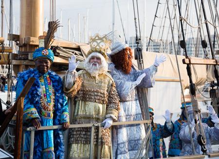 BARCELONA, SPAIN – JANUARY 5, 2017:  Three Magi arriving at port aboard ship to greet people. Barcelona, Spain Editorial