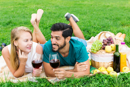 Portrait of smilling couple who are relaxing in time picnic in the park. 写真素材
