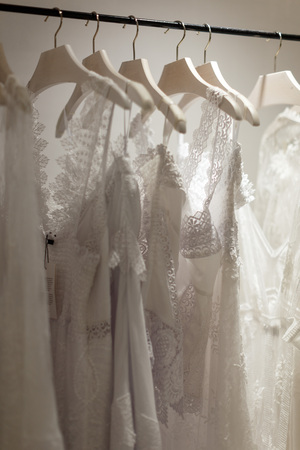 Close up view of stand with wedding gowns in wedding shop