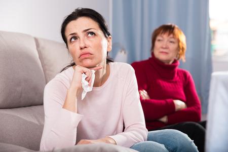Portrait upset adult women looking away after conflict at home interior 写真素材
