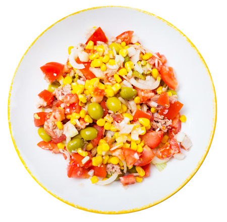Salad with canned tuna, olives and corn. Isolated over white background