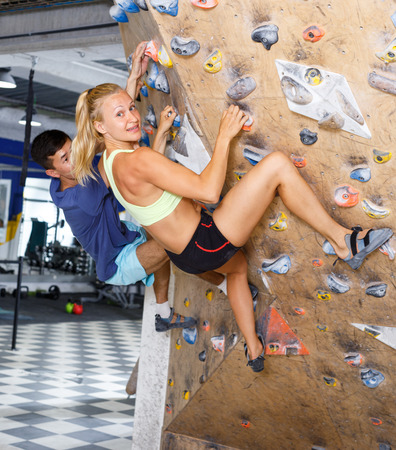 Sporty couple of climbers on joint workout training at bouldering gym Reklamní fotografie