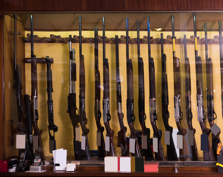 Gun shop interior with specialized rifles on showcase Stock Photo