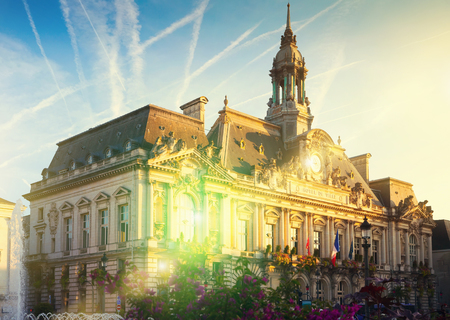 Impressive architecture of Tours Town Hall in rays of morning sun, France
