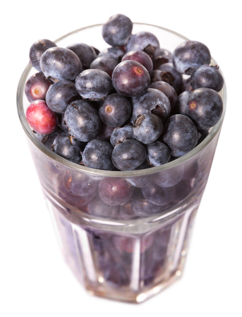 Glass of fresh ripe blueberries. Isolated over white background