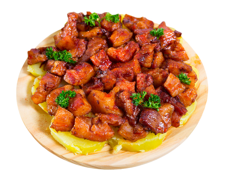 Morro de cerdo a la gallega - spanish dish. Roast nose and cheek pigs with parsley and potatoes. Isolated over white background Reklamní fotografie