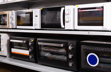 Image of assortment of a  beautiful stylish kitchen microwave at household  appliances store 免版税图像