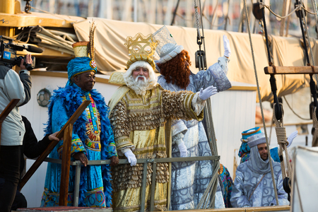BARCELONA, SPAIN – JANUARY 5, 2017:  Three Kings greeting people at port from arriving ship. Barcelona, Catalonia