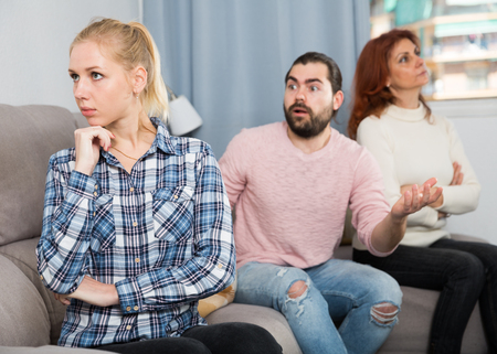 Young married couple and senior mother having bad discussion Imagens