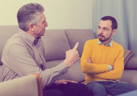 Mature father and son discuss family problems and solve relationship problems Imagens
