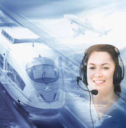 Woman dispatcher assisting in navigating trains during day