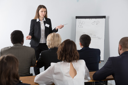 Young business woman giving presentation to international partners at meeting Standard-Bild - 119683667