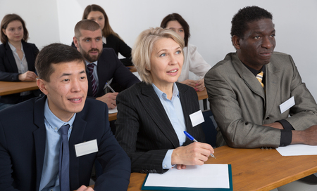 Portrait of focused people of different nationalities during business seminar in lecture hall Standard-Bild - 119684699