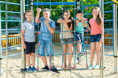 Portrait of children playing at the playground