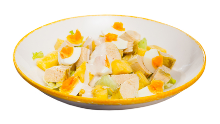 Image of tasty chicken salad with egg and pineapple at plate. Isolated over white background Reklamní fotografie