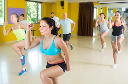 Portrait of   fitness people dancing zumba in dance class
