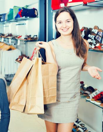 Portrait of adult female in footgear store