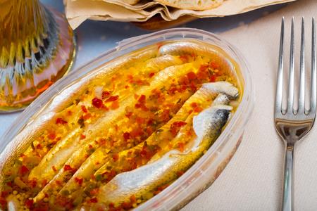 Marinated herring fillet in a plastic jar