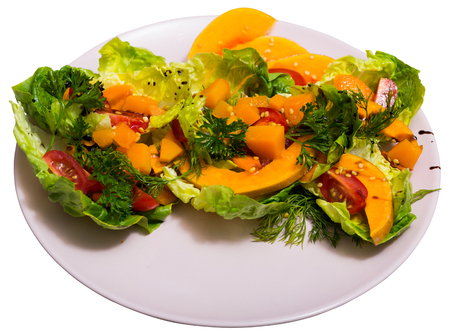 Colorful salad with baked pumpkin. Isolated over white background