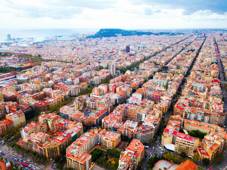 Aerial view of Barcelona cityscape with peculiar geometric grid of Eixample district