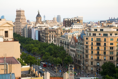 Architecture of Passeig de Gracia main avenue of Barcelona in summer day