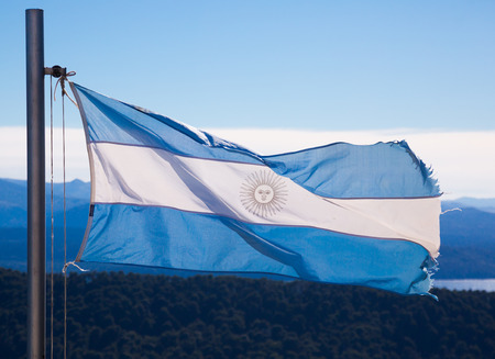 Blue and white flag of Argentina with May sun on white strip. Argentina, South America Foto de archivo